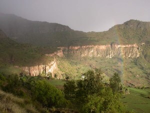 Rainbow comes out over the mountains in Tigray