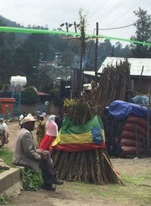 A small Meskal bonfire at Kebena, dropped in the Ethiopian flag, with a cross on the top.