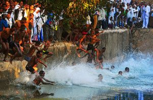 Worshippers jump into the Fasilides baths